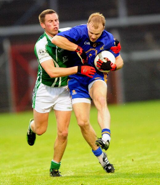Michael Shields bein tackled by Ballincollig forward Patrick Kelly. Picture: Des Barry