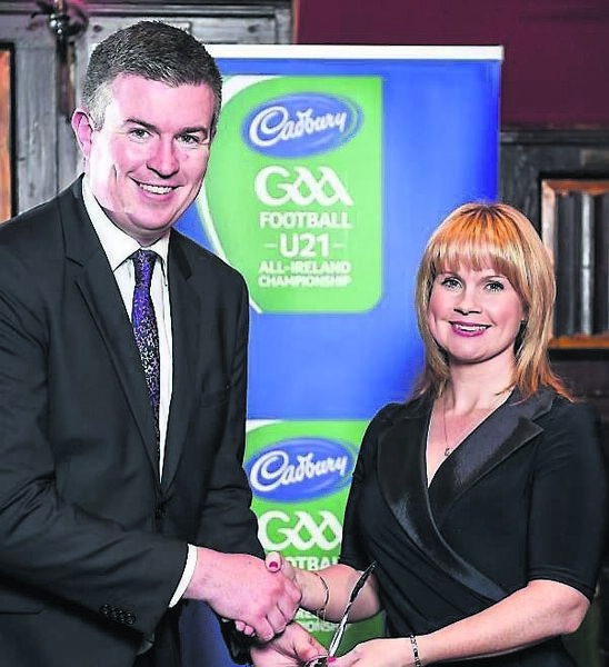 Tracey Kennedy receives her PRO of the Year award, at the 2014 Gaelic Writers Association Awards, from John Fogarty.