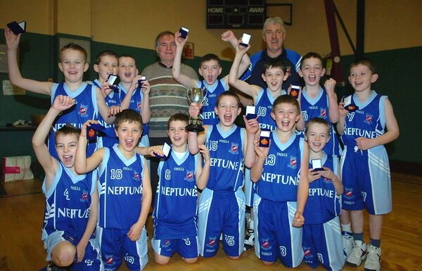 Team captain Jordan Blount with coaches Joe Ahern and Jim Wolfe and the Neptune U11 A back in 2008. Picture: Larry Cummins