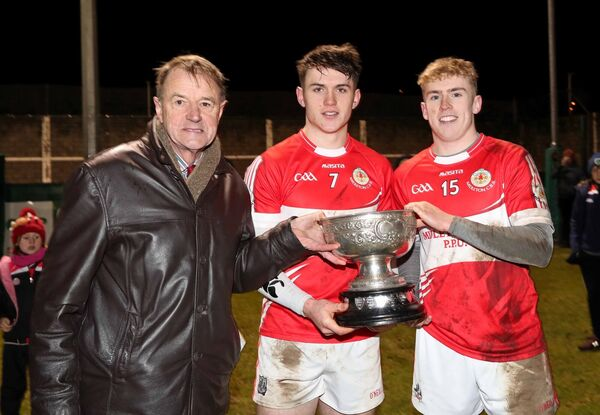 John O'Brien, Chairman Cork Post Primary Schools, presents the O'Callaghan Cup to Sean O'Leary Hayes and Liam Gosnell. Picture: Jim Coughlan