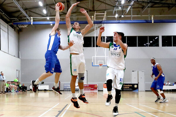UCC's Adrian O'Sullivan and Goran Pantovic of Tralee in action. Picture: INPHO/Bryan Keane