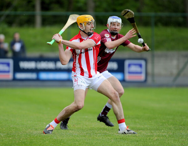 John Cronin about to strike the sliotar away from Bishopstown's Alan O'Sullivan. Picture: Gavin Browne