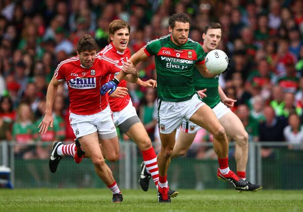 Tomás Clancy tackles Tom Parsons of Mayo. The Rebels need to match the strength and conditioning of the top teams. Picture: Mandatory Credit INPHO/Cathal Noonan