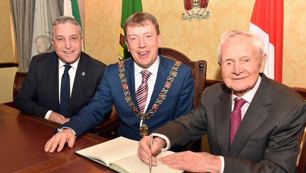 Val O'Connor, proprietor of O'Connor's funeral home, North Gate Bridge who are celebrating 130 years in business, signing the visitors book during a reception hosted by the Lord Mayor Cllr Tony Fitzgerald, with Finbarr O'Connor, managing director. Picture: Eddie O'Hare