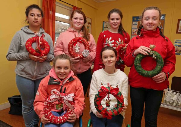 Hafsa Bedri, Niamh Bulman, Rebecca Daly, Jenna Gorman, Ellie Murphy and Ciara Forde, part of Ballyphehane/Togher Community Arts & Crafts Initiative, with their wreaths.Picture: Jim Coughlan
