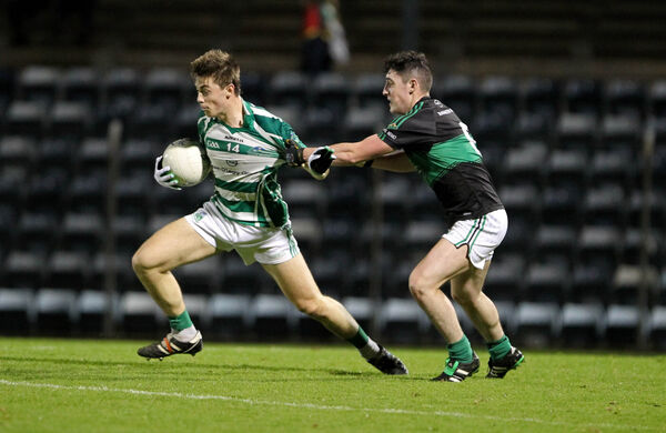 Darragh Kerins, Nemo Rangers, tackles Billy Crowley, Valley Rovers, in the 2015 replay. Picture: Jim Coughlan.