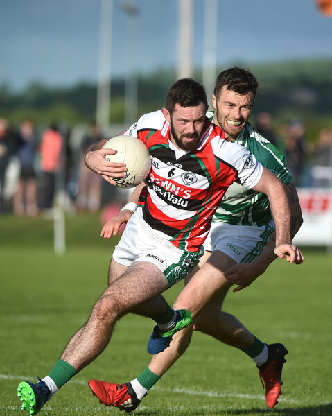 Noel Galvin, Ballincollig, is first to the ball ahead of Fiachra Lynch, Valley Rovers. Picture: Larry Cummins
