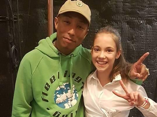 Allie Sherlock with singer Pharrell Williams