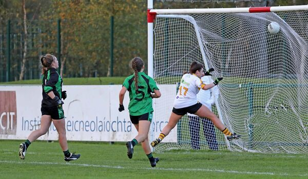 Laura Fitzgerald, Mourneabbey, followes her shot into the goal, watched by Mairead O'Sullivan and Jenny Brew Dinan, St Val's. Picture: Jim Coughlan.