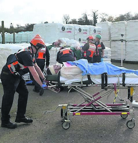 Members of the emergency services dealing with casualties at the simulated accident scene.