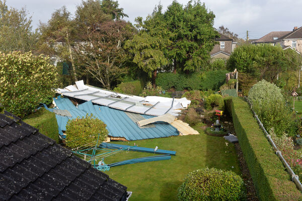 A section of the roof off the Douglas Community School gym which was blown into the garden of Mona Lynch in the height of the hurricane Ophelia. Picture Dan Linehan