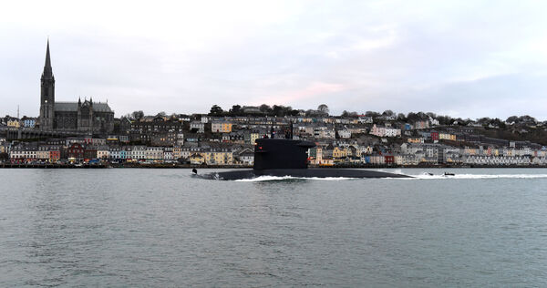 The HNLMS Walrus submarine passes St Colman's Cathedral and the town of Cobh on her way to Horgan's Quay. Pic: Larry Cummins