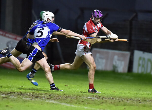 Imokilly's Dan Managan is tackled by Sarsfields' Eoghan Murphy and Craig Leahy. Picture: Eddie O'Hare