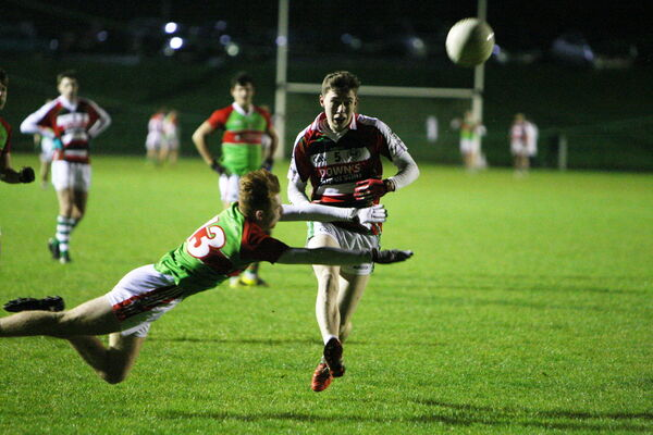 Ballincollig's Luke Fahy passes through Clon's Maurice Shanley's block in the Kelleher Shield final. Picture: Ger Bonus