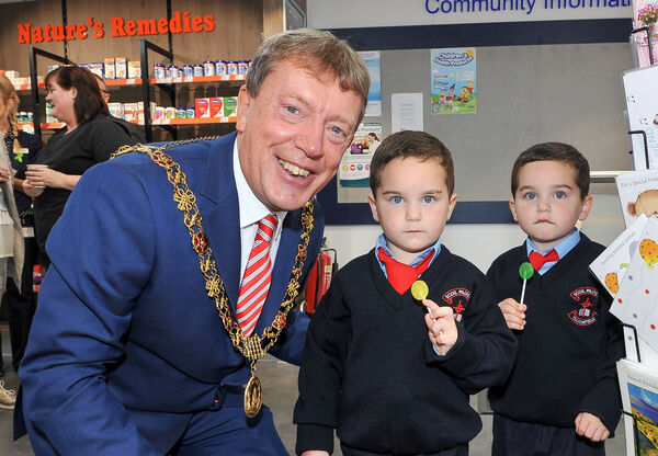 Lord Mayor of Cork Cllr Tony Fitzgerald at the official opening of Phelan's Pharmacy in Gurranabraher, Cork, with twins Jay and Connor Seery from Baker's Road, after their first day in school. Picture: David Keane.