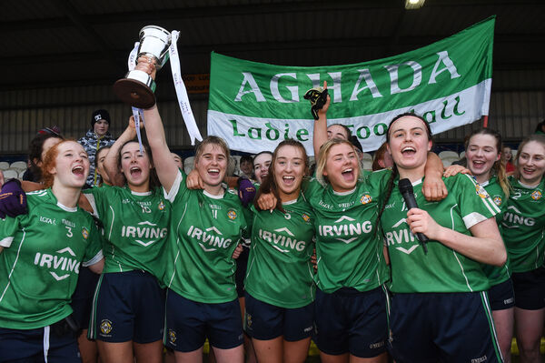 Aghada captain Emma Farmer lifts the cup. Picture: Matt Browne/Sportsfile
