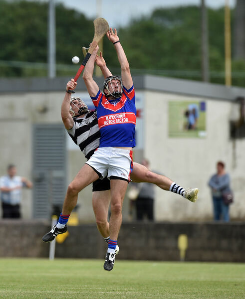 Midleton's Sean O'Leary-Hayes and Erin's Own's Maurice O'Carroll go high for the ball. Picture: Eddie O'Hare