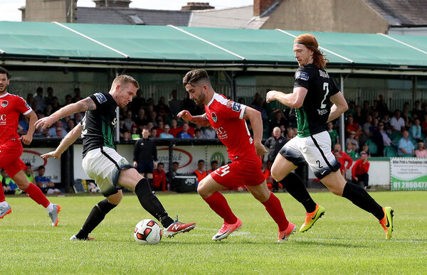 Bray's Hugh Douglas and Conor Kenna try to tackle Seanie Maguire of Cork City. Picture: INPHO/Bryan Keane