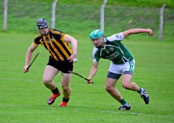 Eoin Hegarty gets away from Ross Cashman. Picture: Denis Boyle
