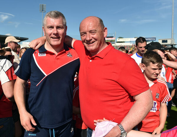 Selector Diarmuid O'Sulivan with Niall Cahalane, father of Damian after defeating Waterford on Sunday. Picture: Eddie O'Hare