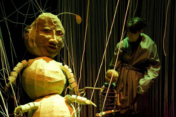 Emma Fisher puppeteering on Pupa. Picture by Emma Mac.