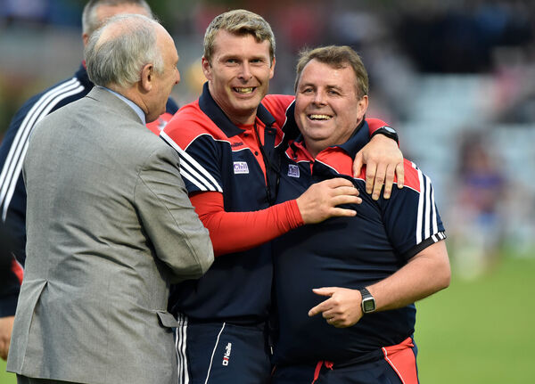 Cork manager Denis Ring celebrates with selector John Dwyer and Frank Murphy, secretary county board.