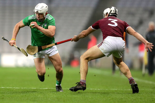 Limerick's Aaron Gillane and Daithí Burke of Galway. Picture: INPHO/Laszlo Geczo