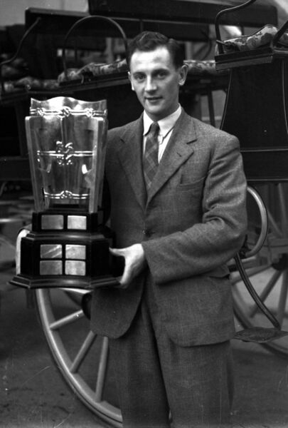 Jack Lynch holding 1942 McCarthy cup.
