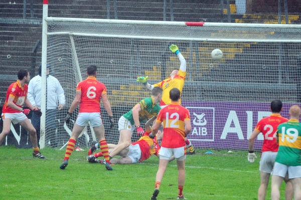 Shane O'Keeffe of St Michael's scores a goal despite the best efforts of Éire Óg keeper Chris Kelly. Picture: Denis Minihane.