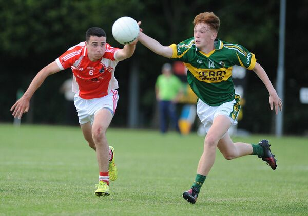 Cork's Joe O'Shea and Kerry South's Cian O'Connor seek out the ball in the Munster U15 Football Tournament Final in Millstreet. Picture: John Tarrant