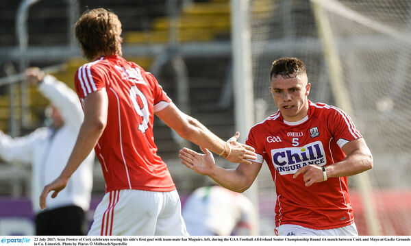 Seán Powter celebrates scoring his side's first goal with team-mate Ian Maguire. Picture: Piaras Ó Mídheach/Sportsfile