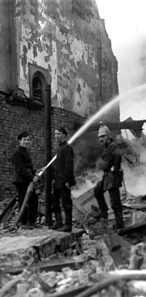 TRAIL OF DEVASTATION: Firefighters train their hose on smouldering buildings in the devastating aftermath of the Burning of Cork on December 12, 1920
