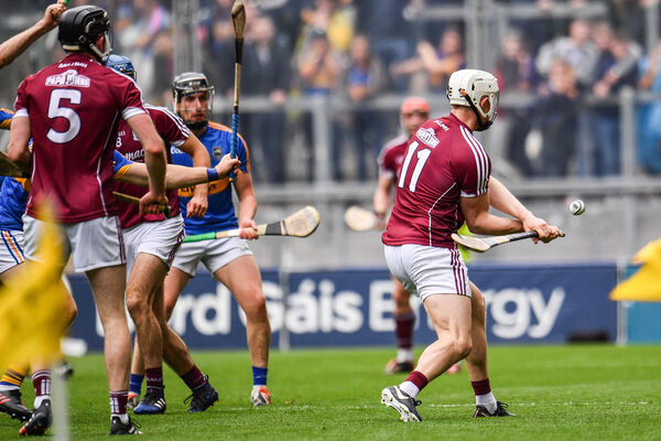 Joe Canning hits the winning point against Tipperary. Picture: Ramsey Cardy/Sportsfile