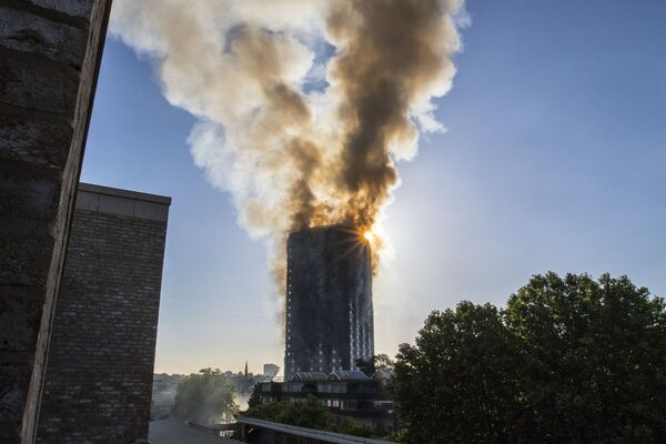 Smoke billows from a fire that has engulfed the 27-storey Grenfell Tower in west London. Pic: Rick Findler/PA Wire