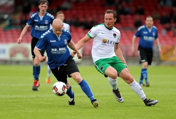 Achille Campion, Cork City, pursues Alan Healy, Wilton Utd. Picture: Jim Coughlan.