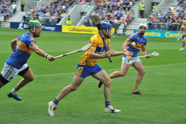 Tipperary defender James Barry chases Shane O'Donnell. Picture: Larry Cummins