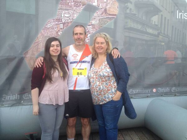 Brendan O'Mahony, Grange Fermoy AC, ran his 100th marathon yesterday, 11 years after his first in Dublin in 2006. He's pictured here with his wife Anne and their daughter Emma. He was presented with champagne by the club and a 100th MCI award after finishing in a time of 3:30:52.