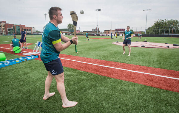 CORK v WATERFORD:Niall Scannell and Jack O'Donoghue try their hand at hurling during Ireland training. Picture: INPHO/Ryan Byrne