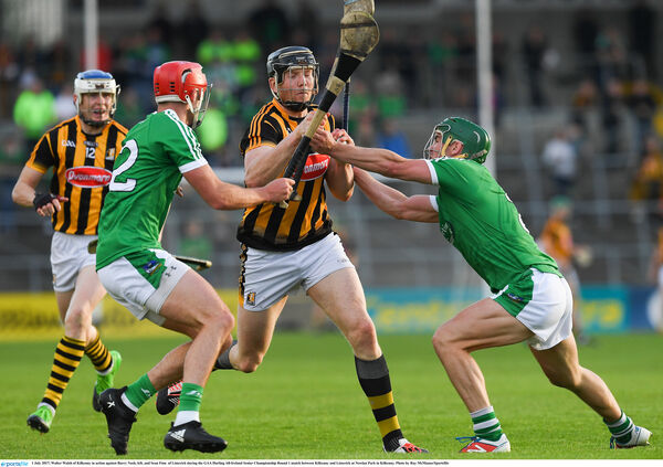 Walter Walsh in action against Barry Nash and Sean Finn. Picture: Ray McManus/Sportsfile