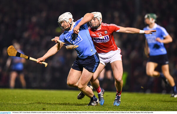 Liam Rushe gets away from Patrick Horgan. Picture: Stephen McCarthy/Sportsfile