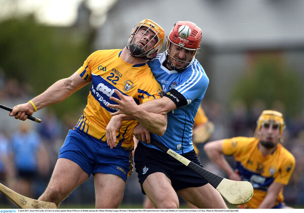 Jason McCarthy of Clare in action against Ryan O'Dywer, with his Cúltec hurley. Picture: Diarmuid Greene/Sportsfile