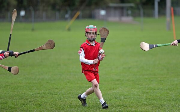 Traditional hurleys at full tilt in a Ballincollig GAA camp. Picture: Jim Coughlan.