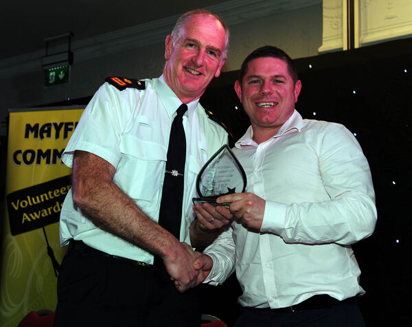 Supt Mick Comyns presents an award to Brian Cronin, Mayfield Boxing Club.