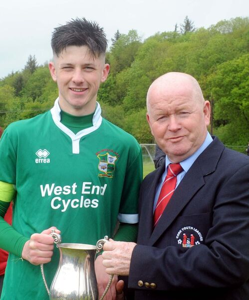 Denis Crowley, secretary, Cork Youth League, presenting the cup to Ballincollig captain Ronan Barrett. Picture: Denis Minihane.
