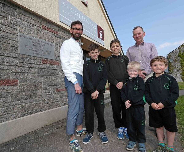 Finbarr Hurley, Principa, on left; Bernard Lynch, Deputy Principal, with Michael O'Donoghue, Jayden Kabia, both sixth class, Alex O'Neill Connolly and Aaron O'Neill, both Junior Infants pictured outside the old school building before it is demolished in the next coming weeks. 	Picture: Jim Coughlan