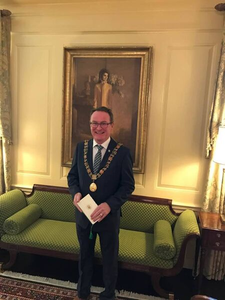 The Lord Mayor of Cork, Cllr Des Cahill in the White House for the St Patrick's Day celebrations in front of a portrait of the former First Lady Jackie Kennedy.