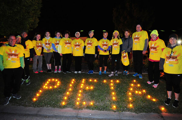 A group taking part in the Ballincollig Darkness Into Light 5k walk/run in aid of Pieta House. Picture: Denis Minihane.