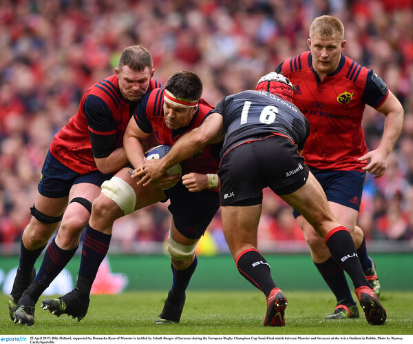 Billy Holland, supported by Donnacha Ryan of Munster is tackled by Schalk Burger of Saracens. Picture: Ramsey Cardy/Sportsfile