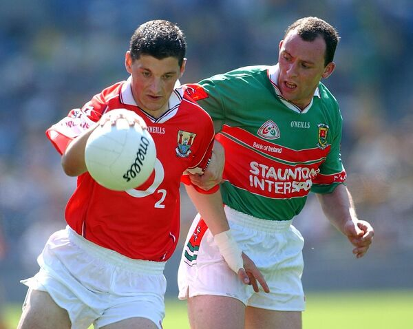 Fionan Murray takes on Mayo's Kenneth Mortimer.