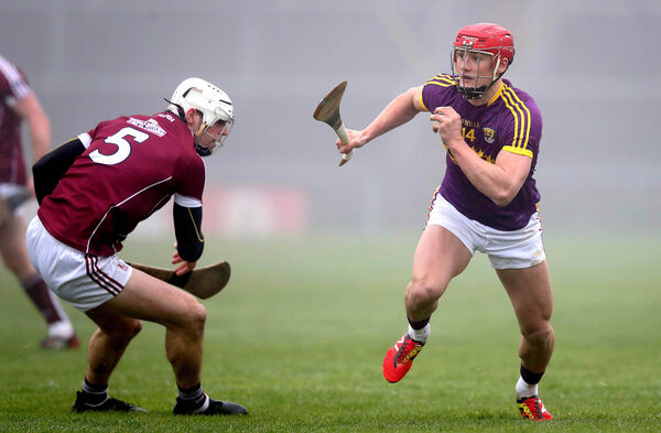 Galway's Gearoid McInerey and Lee Chin of Wexford. Picture: INPHO/Ryan Byrne
